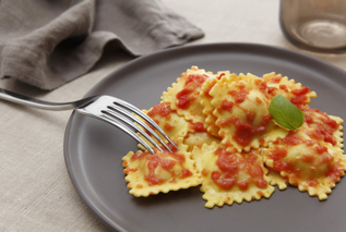 Ravioli in cream and tomato sauce