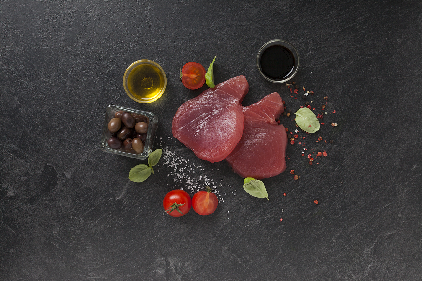Grilled tuna steak with cherry tomatoes and olives